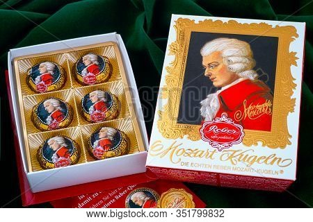 Tambov, Russian Federation - February 14, 2020 Open Box Of Mozart Candies On Green Velvet Background
