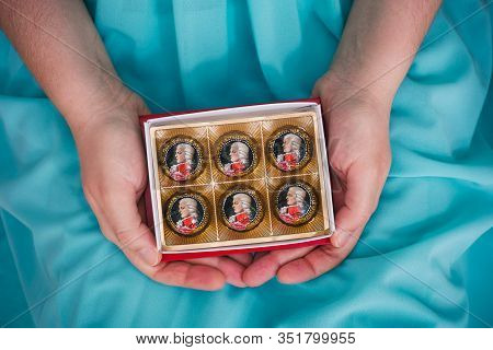 Tambov, Russian Federation - February 14, 2020 Open Box Of Mozart Candies In Woman Hands.