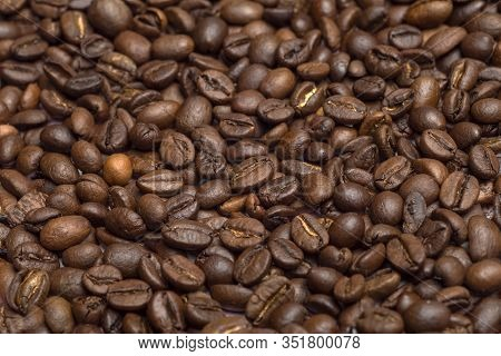 Coffee Beans Background. Coffee Beans Close Up On The Table. Coffe Concept.