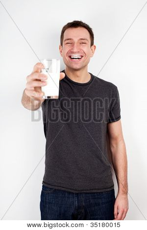 Young Man Smiling With Glass Of Milk