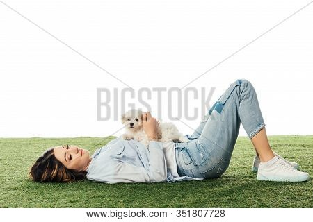 Woman With Havanese Puppy Lying On Grass Isolated On White