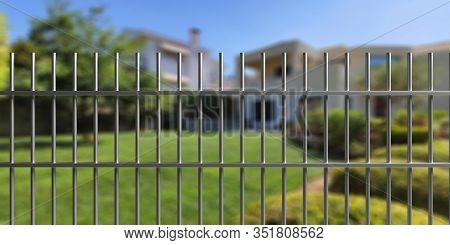 House Safety. Metal Fence With Steel Bars, Blur Residential Building And Garden Background. 3D Illus