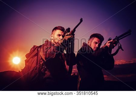 Silhouette Of The Hunter. Rifle Hunter Silhouetted In Beautiful Sunset. Hunting In Russia. Hunting I