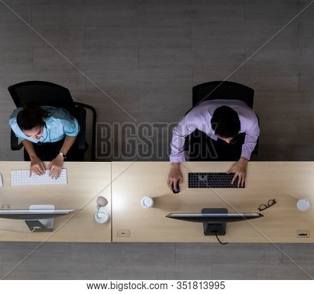 Late Night Environment, Top view of call centre operator team with headsets working in a call centre customer service and technical support. Using for 24 Hr. Call center Concept.