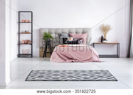 Patterned Black And White Rug On The Floor Of Contemporary Bedroom Interior With Comfortable Bed Wit