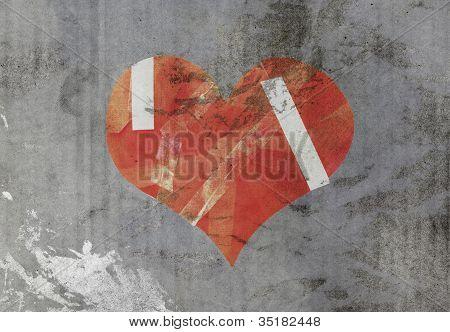 damaged heart on old paper