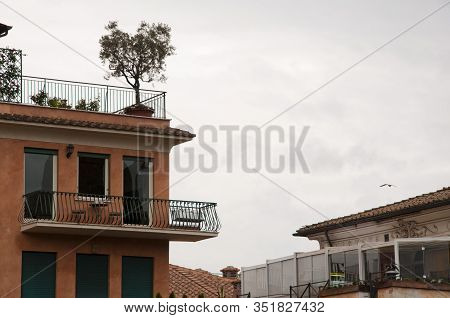 Urban Architecture. Italian Balcony With Flowering Plants And Flowerpots. Balcony Design And Archite