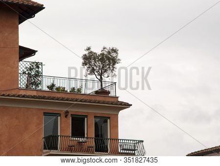 The Notion Of Nature And Open Space. Balcony Design And Architecture. Roof Terrace With Small Balcon