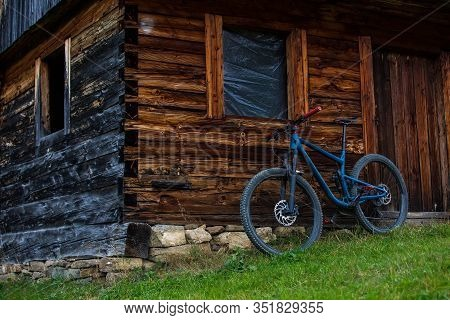 Trail Bike Parking Near An Old Empty Wooden House