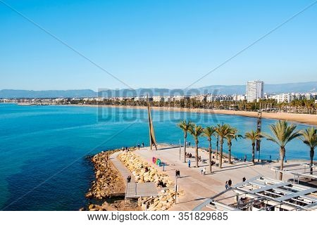 SALOU, SPAIN - JANUARY 12, 2020: Aerial view of Llevant Beach, the main beach of Salou, in the famous Costa Dorada, on a winter Sunday. Salou is a major summer destination for European tourism
