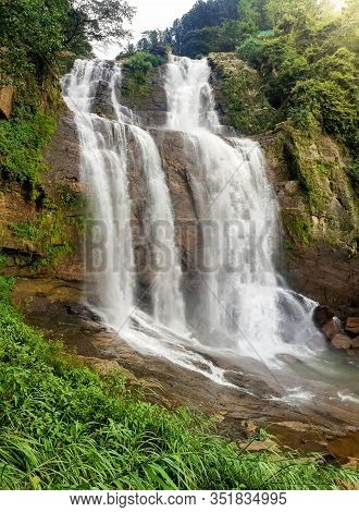 Beautiful Photo Of Big Waterfall In The Jungle Forest At Sunset