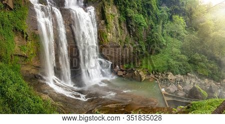 Panoramic Photo Of Waterfal Falling On The Rocks In The Tropical Jungle Forest