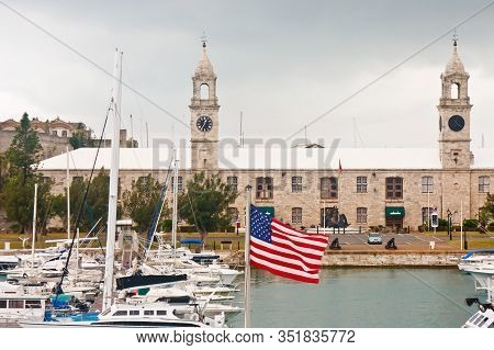The Naval Dockyard In Bermuda With A Marina And American Flag