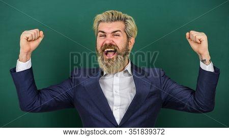 Always Winner. Happy Winner At Green Chalkboard. Bearded Man Make Winner Gesture. Celebrating Excell