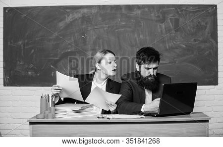 Teacher And Supervisor Working Together In School Classroom. School Educator With Laptop And Princip