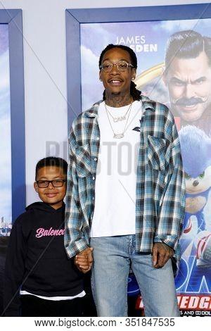 LOS ANGELES - FEB 12:  Wiz Khalifa, son Sebastian at the