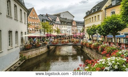 Saarburg, Germany - September 13 2019: City Center Of Saarburg With Creek And Restaurants At The Pro
