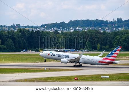 Zurich, Switzerland - July 19, 2018: American airlines airplanes taking-off at day time in international airport