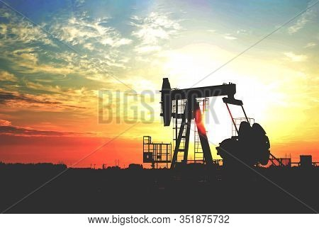 Oil Drilling Derricks At Desert Oilfield For Fossil Fuels Output And Crude Oil Production From The G