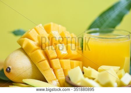 Mango Juice Glass With Mango Slice On Mango Leaves From Tree Tropical Summer Fruit Concept / Sweet R