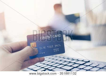 Business Man Holding Credit Card Payment In A Office / Payment Online Shopping Paying With Credit Ca
