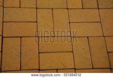 Cobblestone Textured Background.  Yellow Cobblestone Pavement Photo