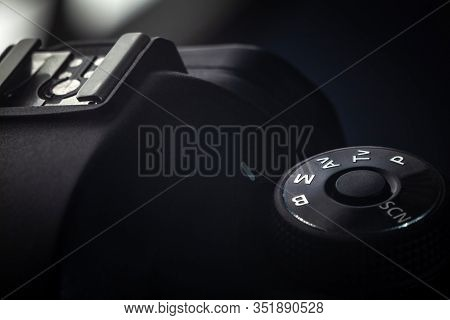 Detailed Close-up Macro Photo Of Black Camera Body With Buttons To Control And Switch Shooting Modes