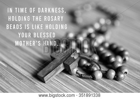 Rosary Inspirational Quote - In Time Of Darkness, Holding The Rosary Beads Is Like Holding Your Bles
