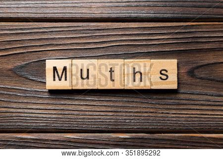 Myths Word Written On Wood Block. Myths Text On Table, Concept