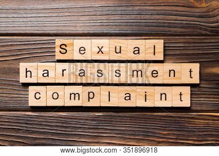 Sexual Harassment Complaint Word Written On Wood Block. Sexual Harassment Complaint Text On Table, C