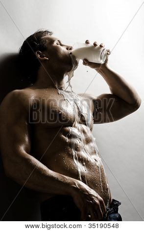 the very sexy muscular handsome sexy guy drink milk and pour on body poster