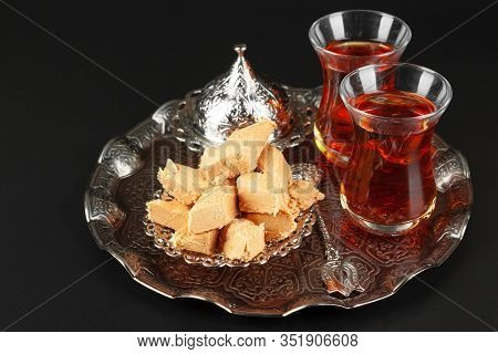 Bowl With Pieces Of Turkish Delight Lokum And Black Tea