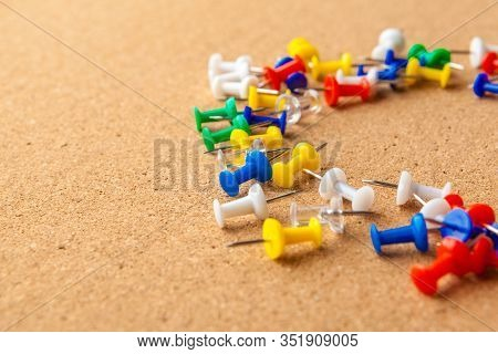 Group Of Colorful Push Pins On Cork Bulletin Board. Creative Photo.