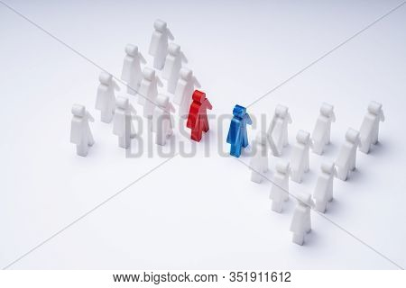 Two Groups Of Pawns Coming Together And Merging On Table