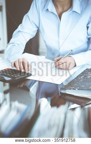 Bookkeeper Woman Or Financial Inspector Making Report, Calculating Or Checking Balance, Close-up. Bu