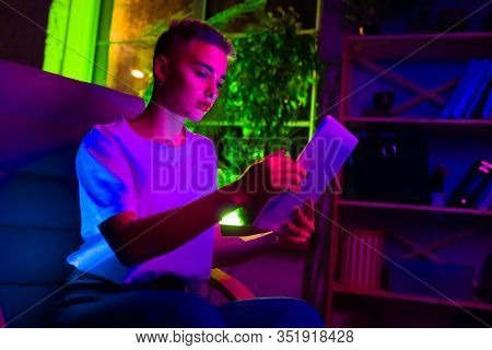 Attented. Cinematic Portrait Of Stylish Woman In Neon Lighted Interior. Toned Like Cinema Effects, B