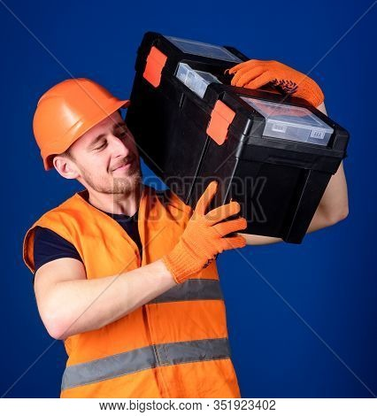 Worker, Repairer, Repairman, Strong Builder On Cheerful Smiling Face Carries Toolbox On Shoulder, Re