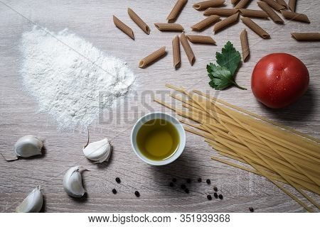 Close Up Pasta Ingredients Food On Table. Healthy Food. Healthy Italian Food. Nutritious Food. Simpl