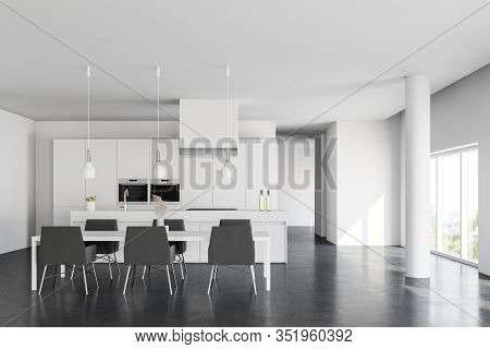 Interior Of Spacious Kitchen With White Walls, Concrete Floor, White Island With Built In Sink And C