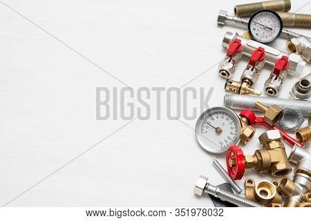 Plumbing Flat Lay Concept Background With Copy Space. Various Water System Accessories On White Back