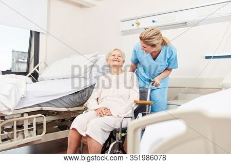 Senior citizen in wheelchair is being cared for by geriatric nurse