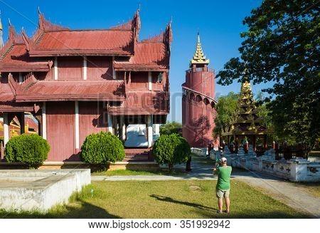 Mandalay, Myanmar - January 8, 2019: Mandalay royal Palace, Tourist taking photos of buildings inside of palace compound