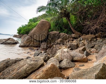 Photo Of Rocks And Cliffs On The Shore At Ocean Lagoon