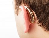 Hearing aid on the man's ear closeup poster