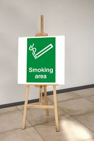 This Is A Designated Smoking Area Sign On A Board In Front Of The Restaurant Entrance. Designated Sm