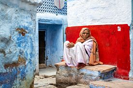 Jodhpur, India - December 9, 2019: An Elderly Woman In Traditional Clothes Sitting On A Bench In An