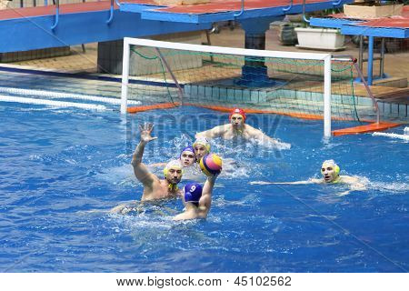 MOSCOW - APR 20: Game in front of goal in match on water polo of Sports complex, on April 20, 2012 in Moscow, Russia