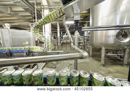 MOSCOW - MAY 16: Green cans go on conveyor in Ochakovo factory, on May 16, 2012 in Moscow, Russia. Ochakovo company was founded in 1978 on eve of Olympic Games 80.