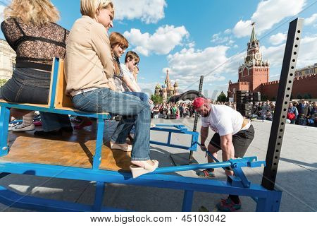 MOSCOW - MAY 26: Strongman is ready to raise a heavy load on VIII Forum Ready for Labor and Defense on May 26, 2012 in Red Square, Moscow, Russia.