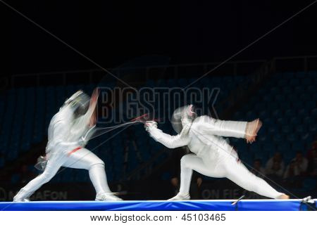 MOSCOW - APR 6: Fight in motion on championship of world in fencing among juniors and cadets, in Sports Olympic complex, on April 6, 2012 in Moscow, Russia